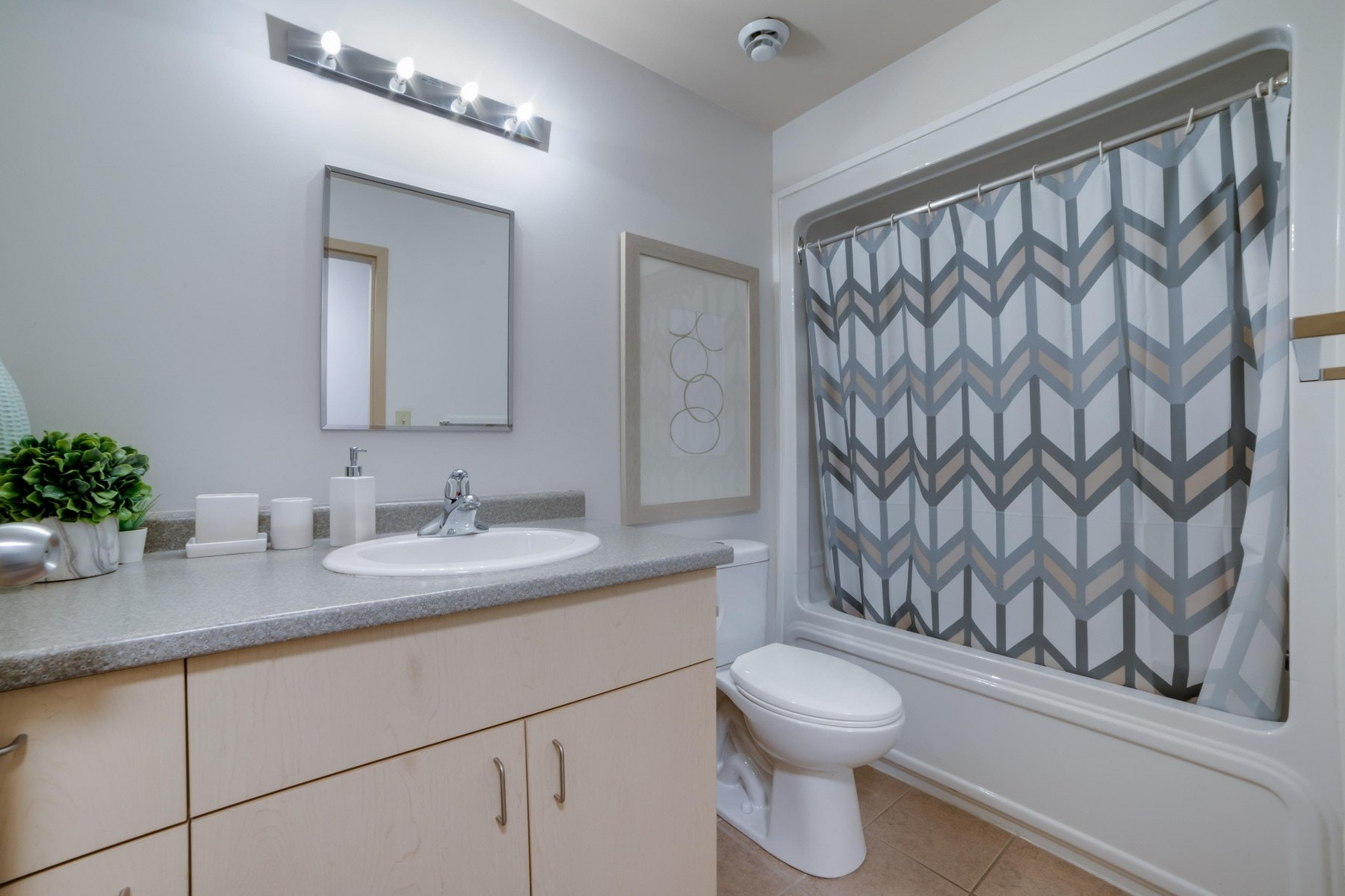 3 piece bathroom with shower, sink and toilet