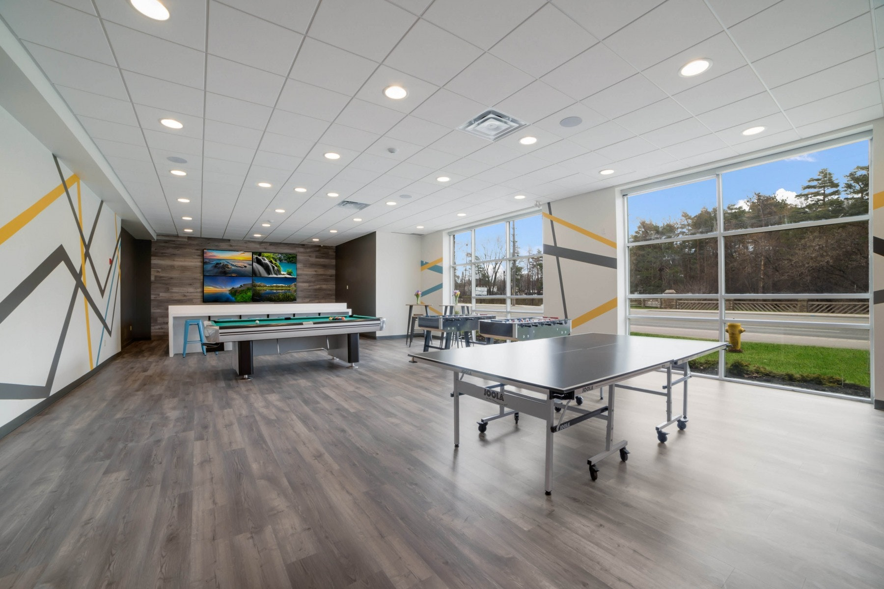 Games room with big screen tv, pool table, ping pong table and arcade games