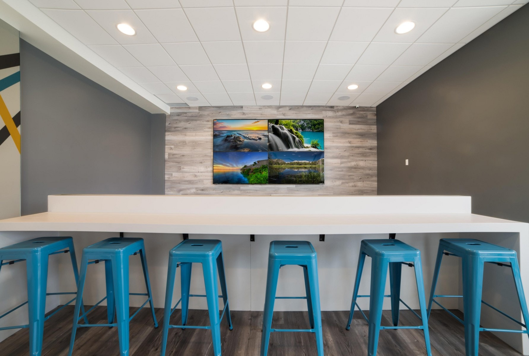 Big screen tv with high table top seating and bar stools
