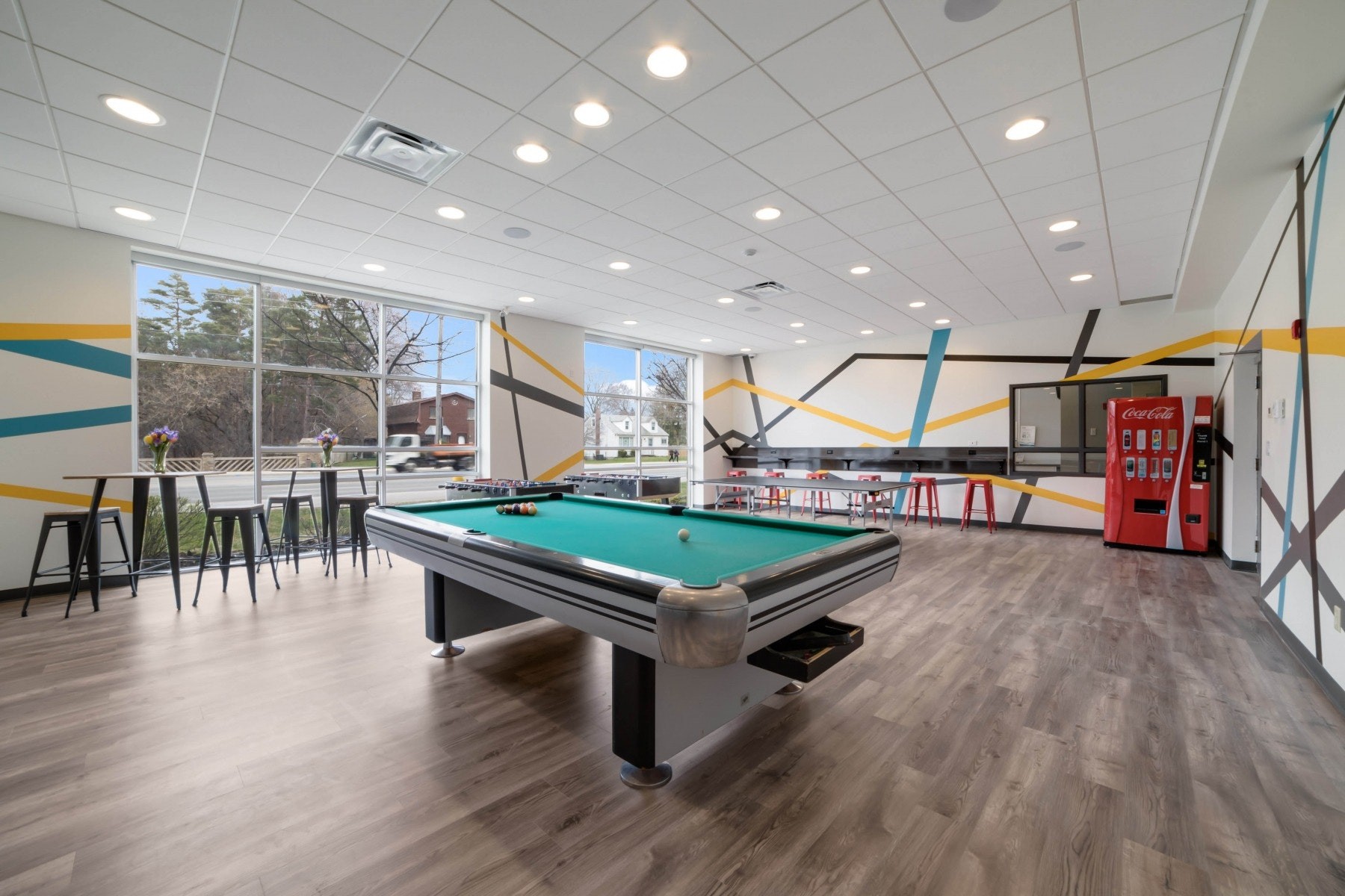 Games room with pool table and seating