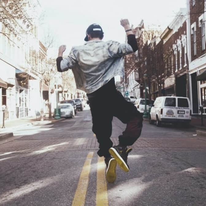 a man dancing in the middle of the street