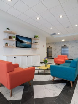 lobby with couches and tv