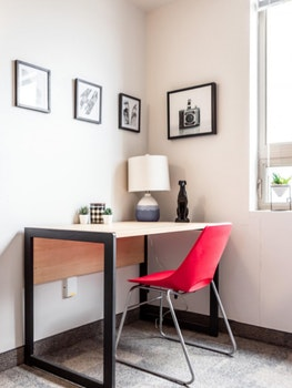 desk with chair and pictures on wall