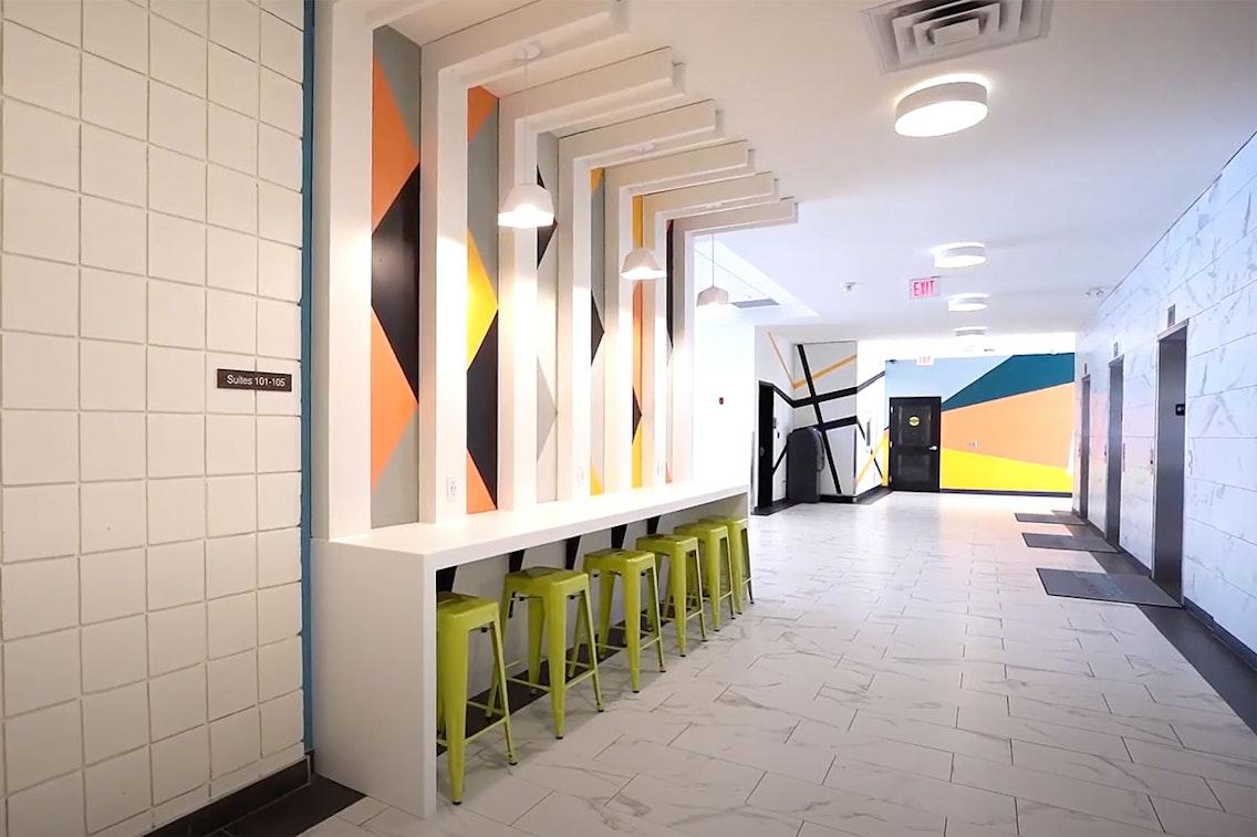 Lobby hallway of 17Hundred with stools